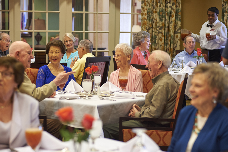 Residents of Redstone village enjoying dinner