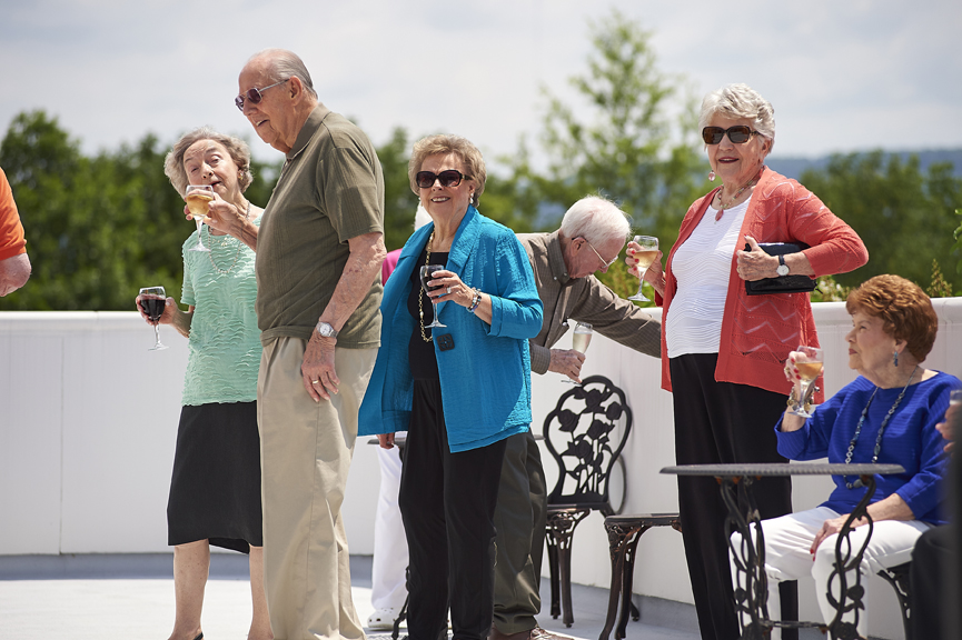 Residents of Redstone Village enjoying wine