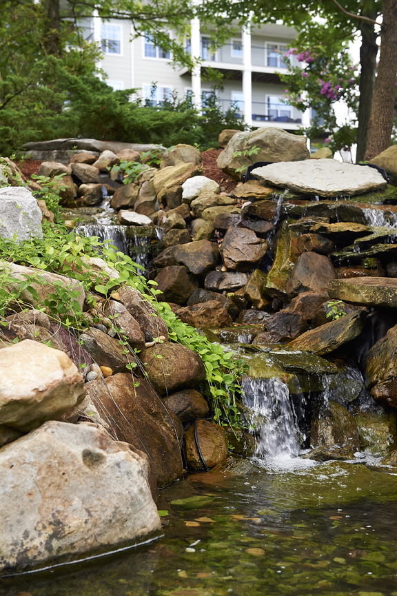 rock waterfall pond outside of Redstone Village